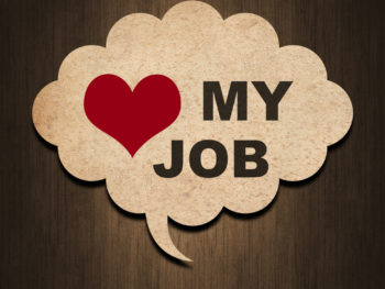"Graphic of a cork board thought bubble in front of a wood grain background with a red heart and the words ""my job"" in the thought bubble."