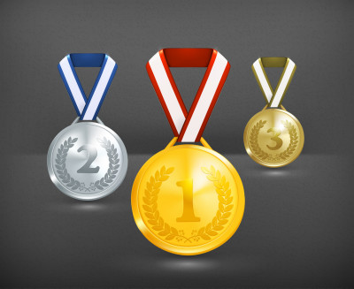 Three medals -- gold, silver, and bronze, with the numbers one, two, and three showcased on each one, respectively.
