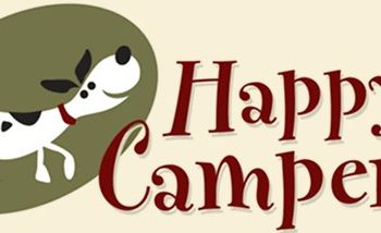"A beige, green, and red banner with a cartoon dog wagging its tail that reads, ""Happy Camper."""